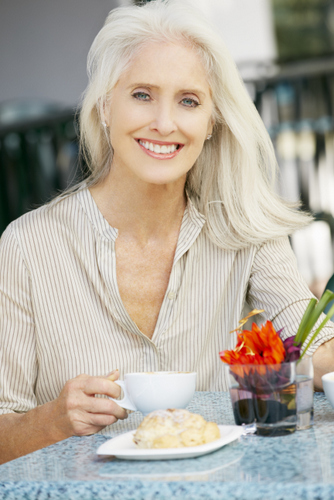 woman looking younger with dental implants