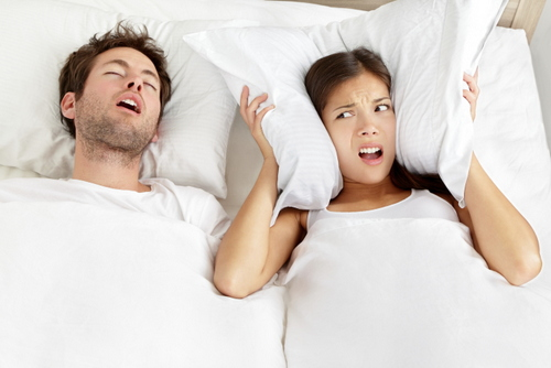 A woman that can't sleep due to her husband snoring loudly!
