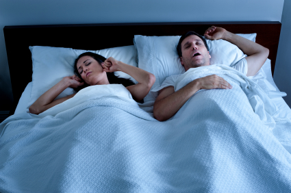 Solutions for snoring couple in bed